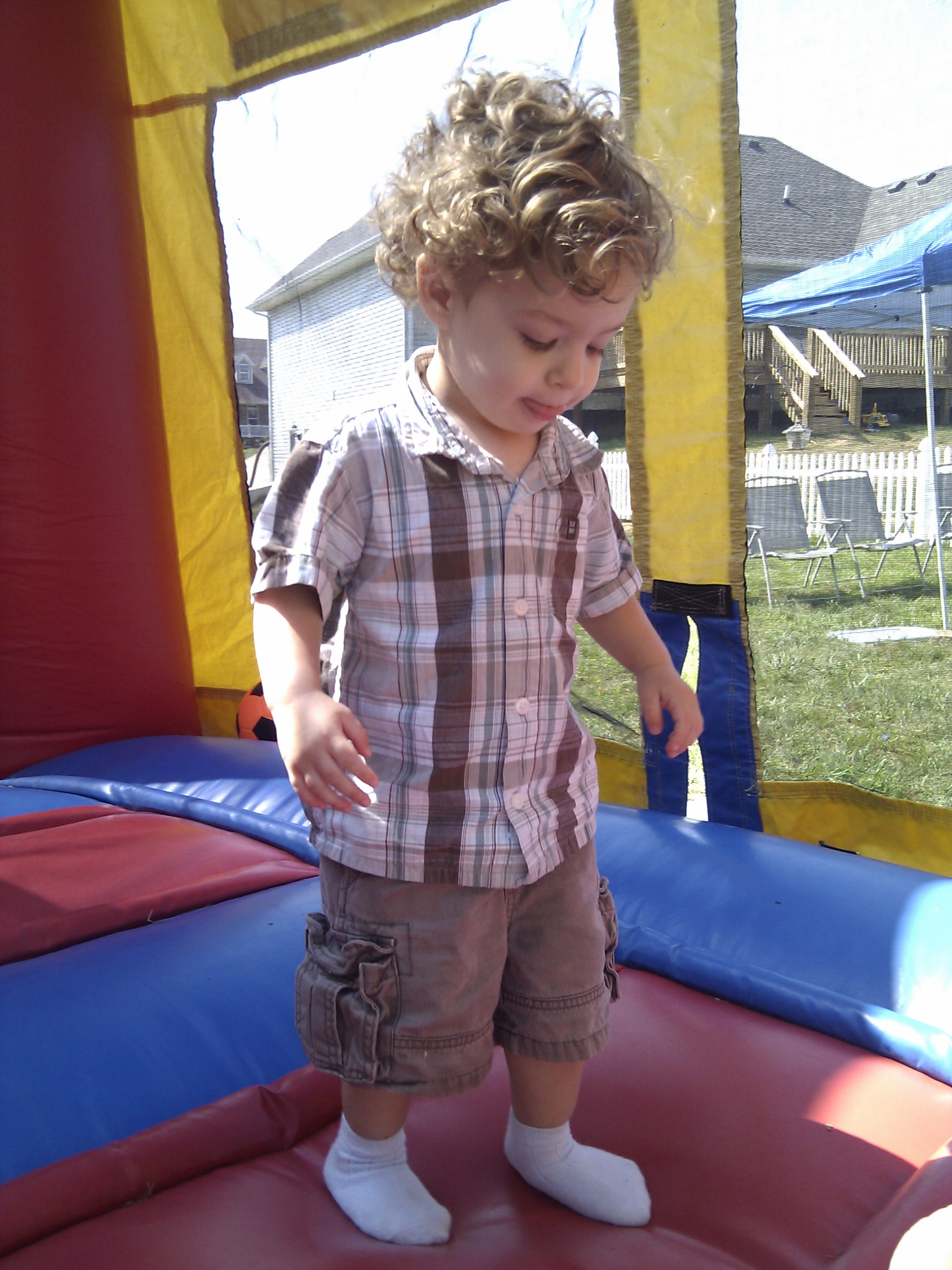 Caleb in the bounce house